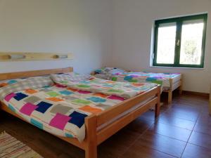 Postel nebo postele na pokoji v ubytování Kod Male Gospe