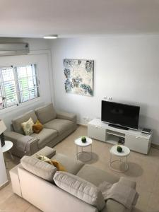 A seating area at Las Velas apartment