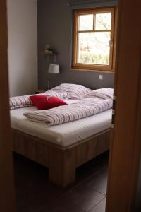 A bed or beds in a room at Apartments Waldemar
