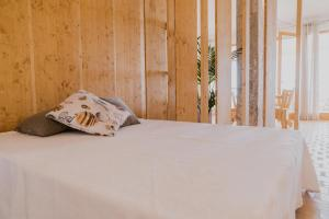 A bed or beds in a room at Moll Petit - Turismo de Interior