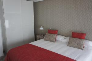 Ein Bett oder Betten in einem Zimmer der Unterkunft Arizonica Suites
