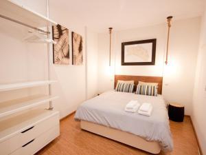 Ein Bett oder Betten in einem Zimmer der Unterkunft Gran apartamento de diseño @plazasanmiguel *lujo*