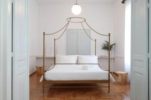 A bed or beds in a room at Live in Athens, THISEIO Historic House