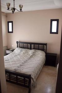 Un ou plusieurs lits dans un hébergement de l'établissement Marina Saidia