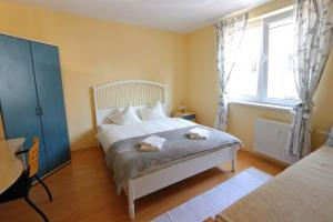 A bed or beds in a room at Apartmán Hanka