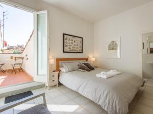 Een bed of bedden in een kamer bij San Lorenzo Terrace Duomo View