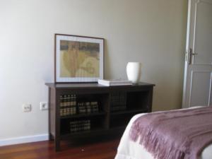 Cama ou camas em um quarto em Casa do Terraço
