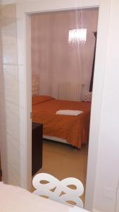 A bed or beds in a room at San Sebastiano Apartment