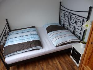 Postel nebo postele na pokoji v ubytování Schöne komplette Ferienwohnung in Wesel
