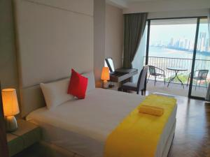 A bed or beds in a room at The Landmark Seaview Gurney