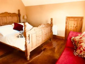 A bed or beds in a room at The-Gables