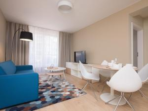 A seating area at Apartament Hello Halicka 5