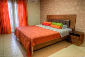 Glauke Rooms tesisinde bir odada yatak veya yataklar