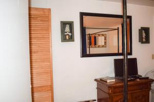 A television and/or entertainment center at Bahamian Touch Rentals