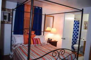 A bed or beds in a room at Bahamian Touch Rentals