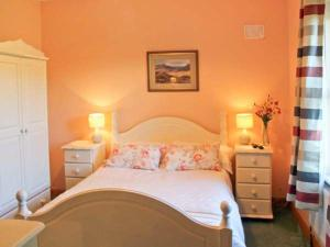 A bed or beds in a room at Grange Lodge, Strokestown