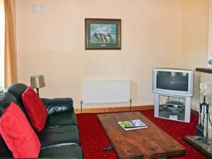 A television and/or entertainment centre at Grange Lodge, Strokestown