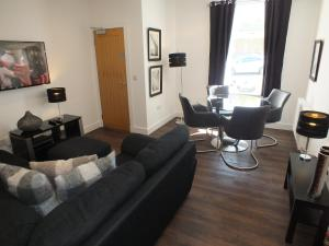 A seating area at Prestwick Suites Luxury Apartment