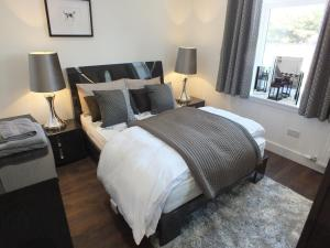 A bed or beds in a room at Prestwick Suites Luxury Apartment