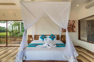 Un ou plusieurs lits dans un hébergement de l'établissement Green Sala Villa