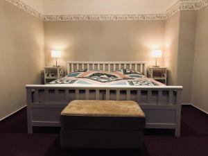 Ein Bett oder Betten in einem Zimmer der Unterkunft Ferienwohnung Südel