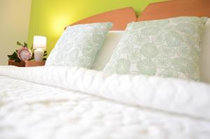 Cama o camas de una habitación en pietro family apartment