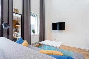 Säng eller sängar i ett rum på ApartDirect Hammarby Sjöstad