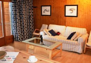 Ein Sitzbereich in der Unterkunft Appartements Hortensia