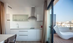 A kitchen or kitchenette at Apartamentos Maier