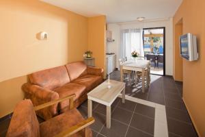 Predel za sedenje v nastanitvi Apartments Sol Amfora for Plava Laguna