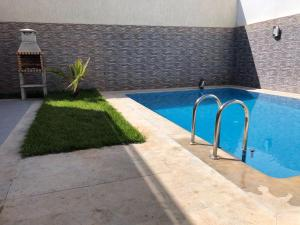 The swimming pool at or near Villa Nour