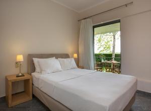 Ένα ή περισσότερα κρεβάτια σε δωμάτιο στο Fragos Garden Studios