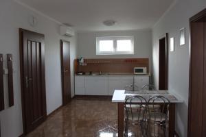 Кухня или мини-кухня в Privat Arcadia