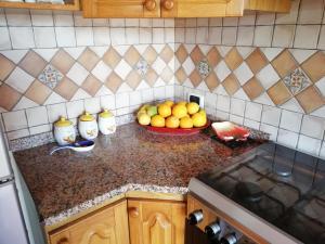 A kitchen or kitchenette at Casa Delle Rose