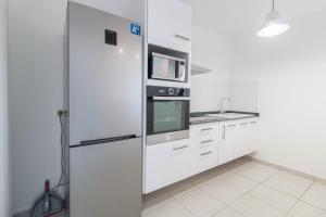 A kitchen or kitchenette at Sun Apart
