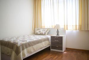 A bed or beds in a room at San Isidro apartment
