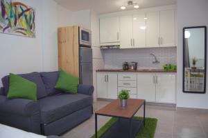 Céntrico Apartamento con Balcón cerca de la Playaにあるキッチンまたは簡易キッチン