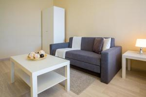 A seating area at Lux-Apartments 2-y Spasonalivkovskiy