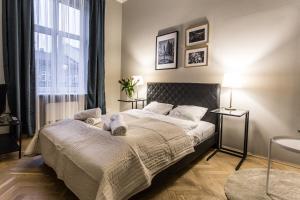 Lova arba lovos apgyvendinimo įstaigoje Vistula Apartments