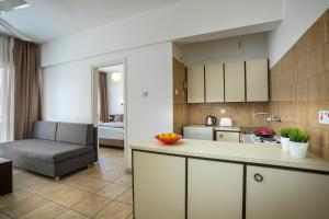 A kitchen or kitchenette at Costantiana Beach Hotel Apartments