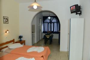 A bed or beds in a room at Studios Alsos