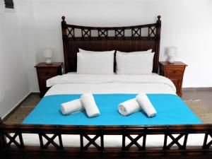 A bed or beds in a room at Santorini Traditional Suites