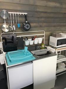 Een keuken of kitchenette bij Check-Inn 1