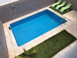 A view of the pool at Villa Nour or nearby
