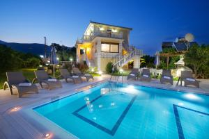 The swimming pool at or near Villa Alonia