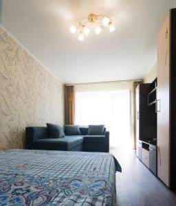 A bed or beds in a room at Apartment Lokomotivnaya