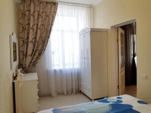 Кровать или кровати в номере Апартаменты Зефир на Нахимова