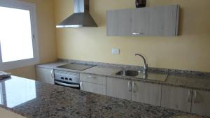 A kitchen or kitchenette at Apartamentos Cala Llonga