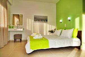 A bed or beds in a room at Esthisis Suites Chania