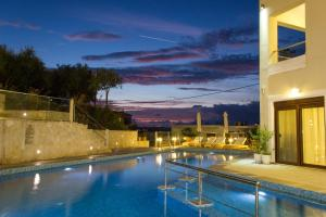 The swimming pool at or near Esthisis Suites Chania